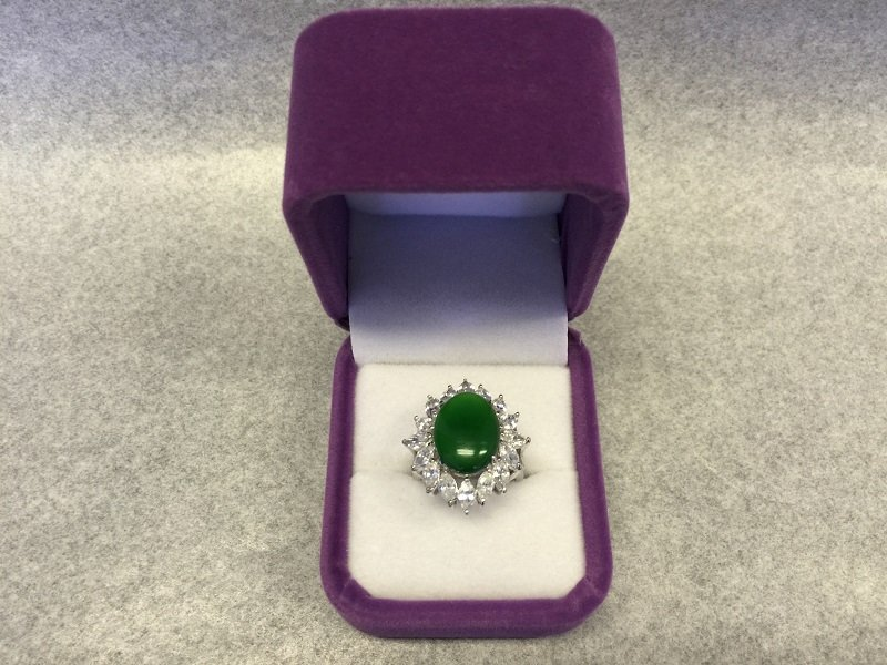 A Nicely Carved Green Jadeite Woman Ring With Diamond