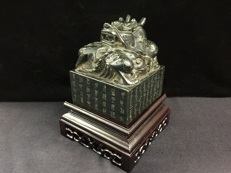A Finely Carved Spinach Jade Dragon Seal