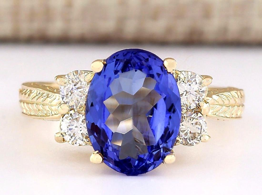 4.10 CTW Natural Tanzanite And Diamond Ring In 14k