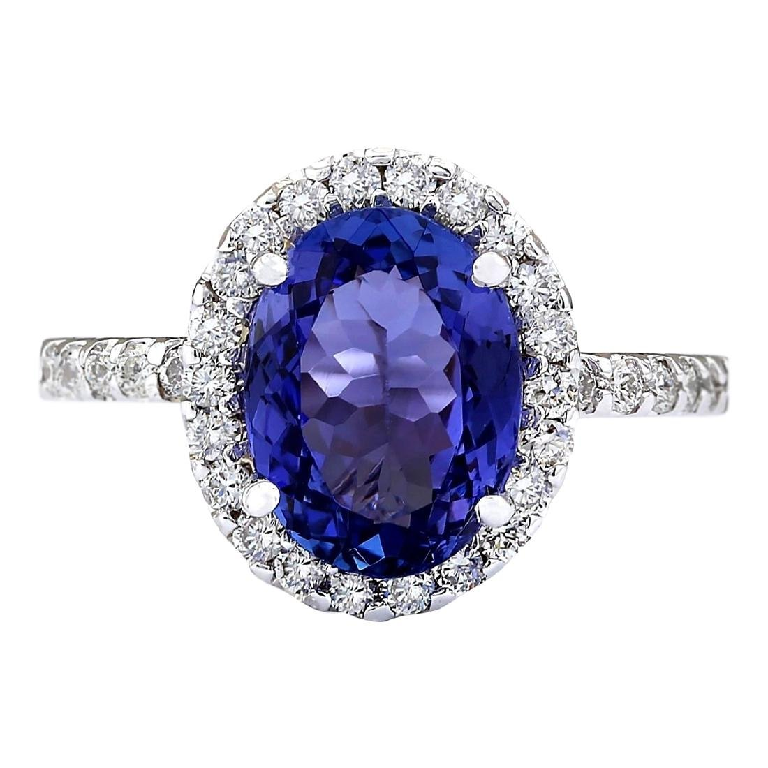 3.63 CTW Natural Blue Tanzanite And Diamond Ring 18K