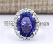 363 CTW Natural Blue Tanzanite And Diamond Ring 18K