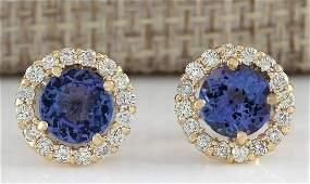 365 CTW Natural Blue Tanzanite And Diamond Earrings