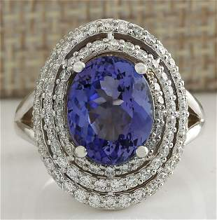 5.89 CTW Natural Blue Tanzanite And Diamond Ring In 14K