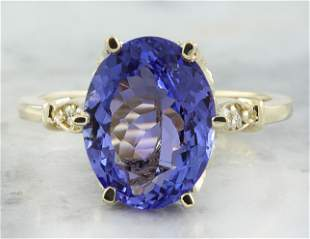 4.85 CTW Tanzanite 14K Yellow Gold Diamond ring