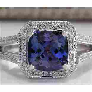 3.67 CTW Natural Blue Tanzanite And Diamond Ring In 18K