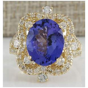 6.47 CTW Natural Blue Tanzanite And Diamond Ring In 14K