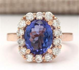 4.33 CTW Natural Blue Tanzanite And Diamond Ring In 18K