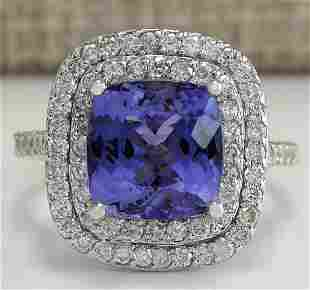 6.09 CTW Natural Blue Tanzanite And Diamond Ring In 18K