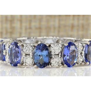 6.94 CTW Natural Tanzanite And Diamond Ring In 18K
