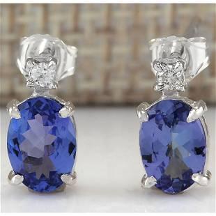 1.73 CTW Natural Blue Tanzanite And Diamond Earrings
