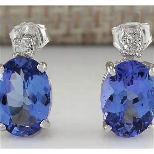 3.26 CTW Natural Tanzanite And Diamond Earrings 14K