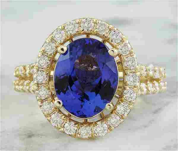 4.85 CTW Tanzanite 18K Yellow Gold Diamond Ring