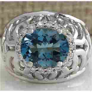 3.95 CTW Natural London Blue Topaz And Diamond Ring In
