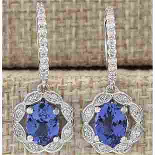 2.21 CTW Natural Blue Tanzanite And Diamond Earrings In