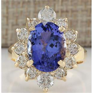 6.18 CTW Natural Blue Tanzanite And Diamond Ring In 18K