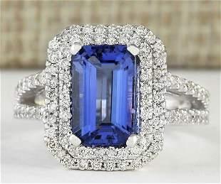 5.23 CTW Natural Blue Tanzanite And Diamond Ring 18K