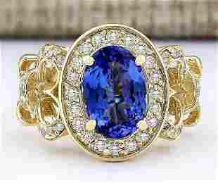 3.93 CTW Natural Tanzanite And Diamond Ring In 18K