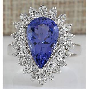 5.73 CTW Natural Blue Tanzanite And Diamond Ring In 18K