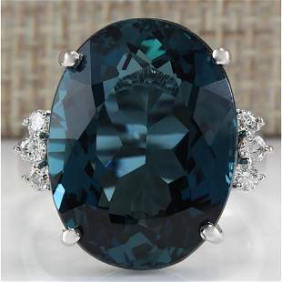 25.32 CTW Natural London Blue Topaz And Diamond Ring
