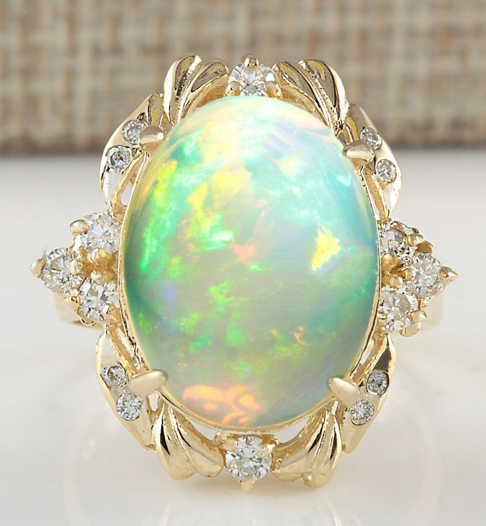 8.87CTW NATURAL OPAL AND DIAMOND RING IN 14K YELLOW
