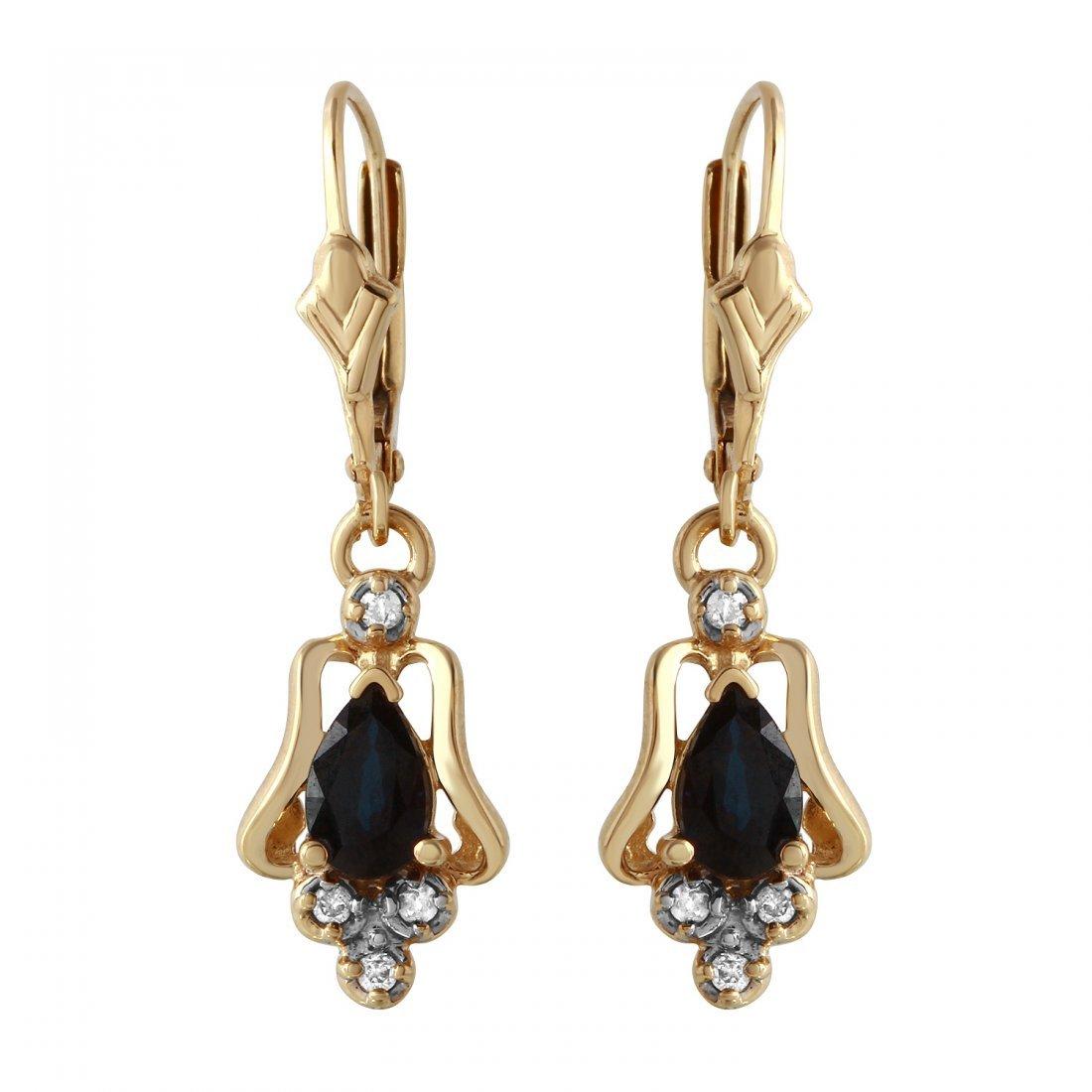 Ladies 1.08CTW Diamond And Sapphire 6x4mm 14K Yellow