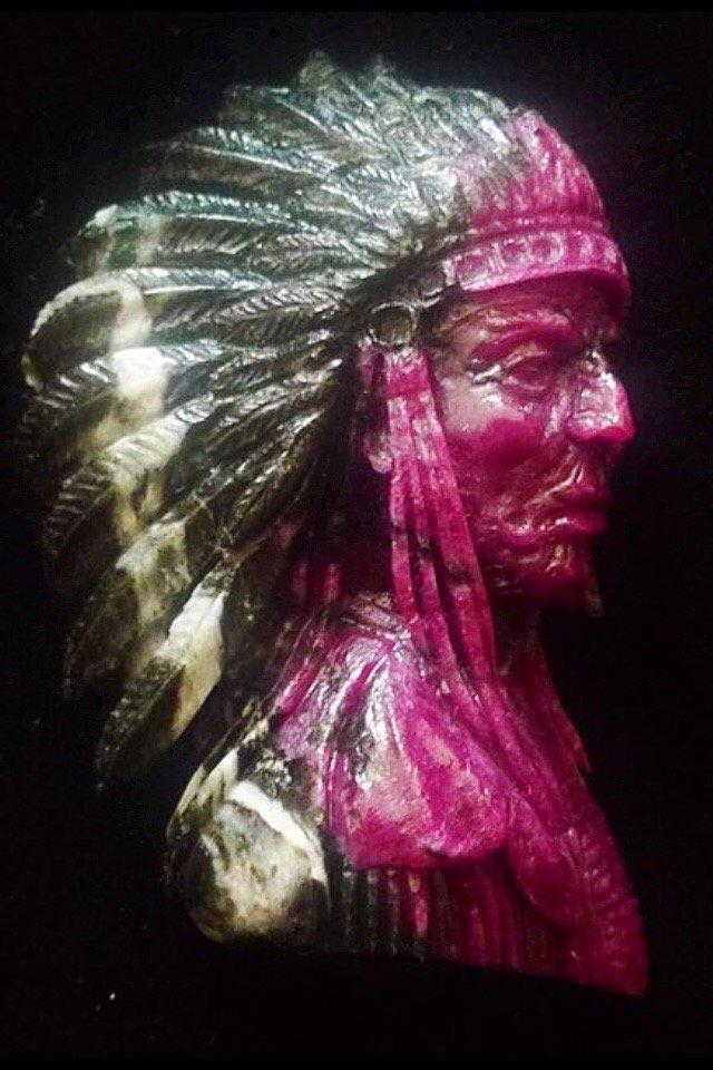 Pinkish red ruby hand carved by Przemyslaw Kus.
