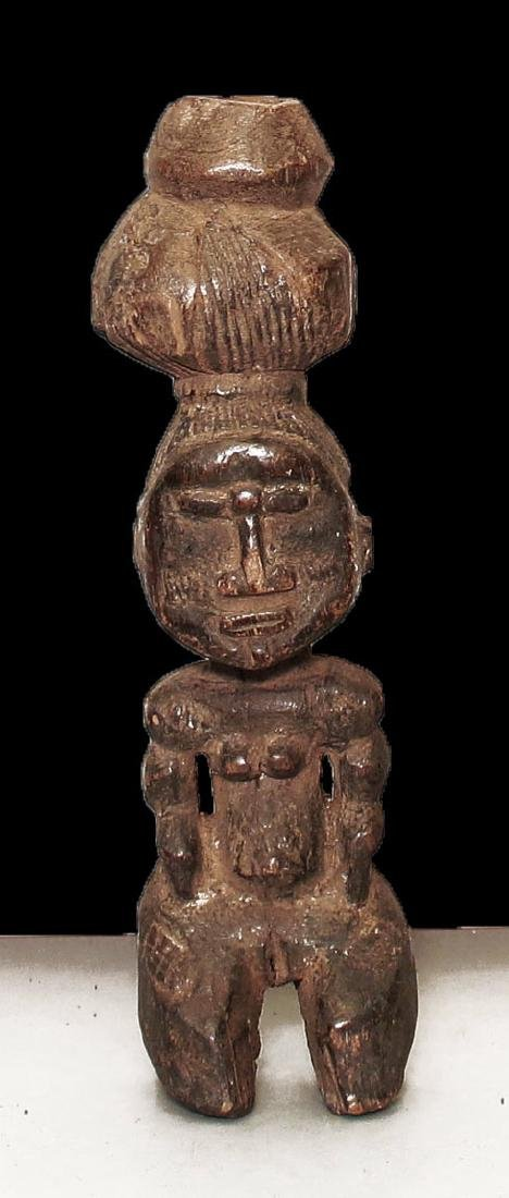 Ivory coast Djimimi people Carved wooden statue. 35 cm