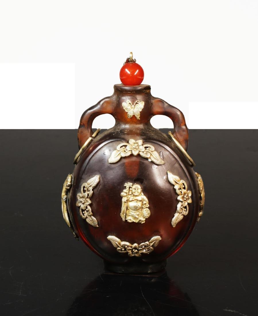Min Guo period. 1920 circa. Amber glass snuff bottle