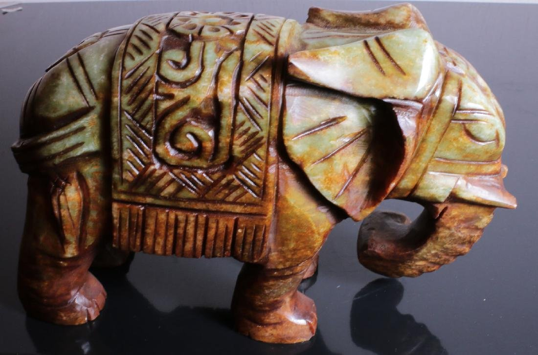 Carved elephant jade. Green-brown colour - 9