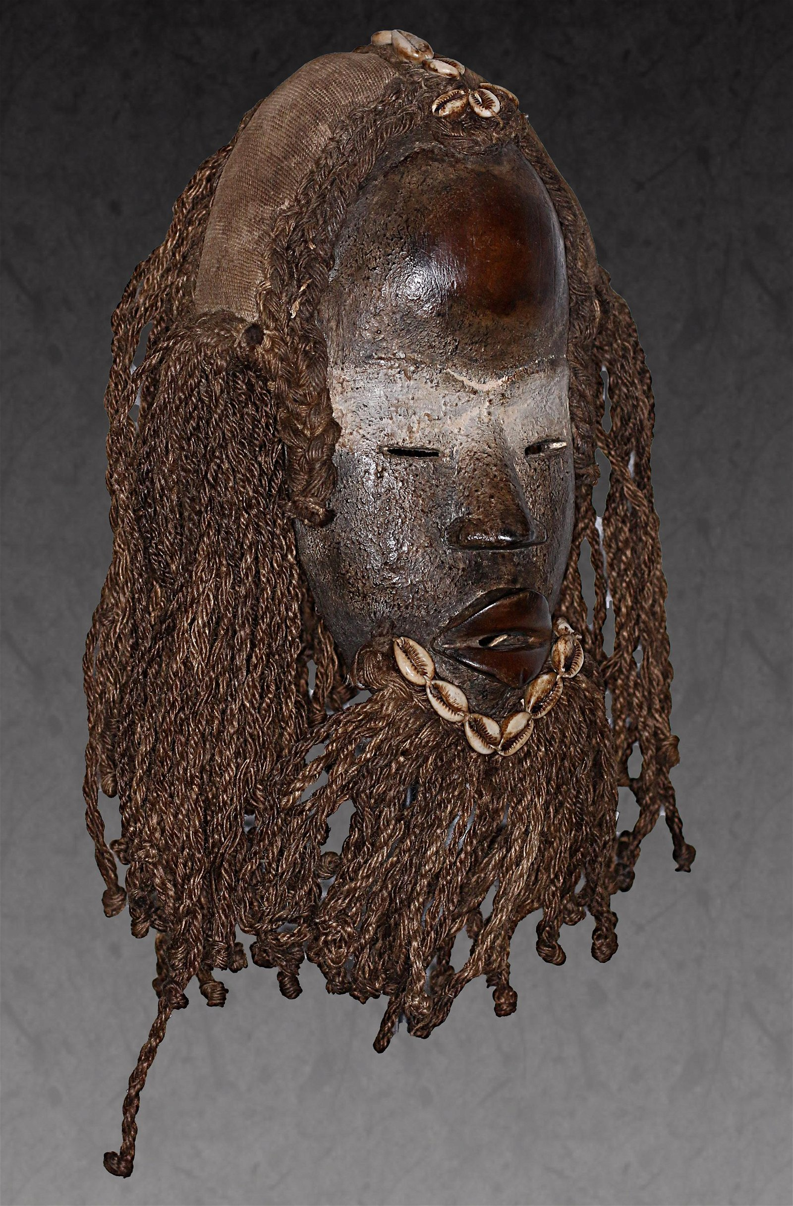 IVORY COAST Dan people Carved wooden mask ornate with