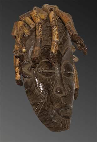 Angola. 1950 circa. Impressive Chokwe mask. Decorated