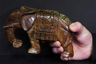 Carved elephant jade. Green-brown colour