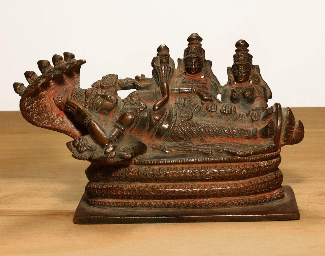 Nepal. Bronze temple statue of sleeping Vishnu. Early