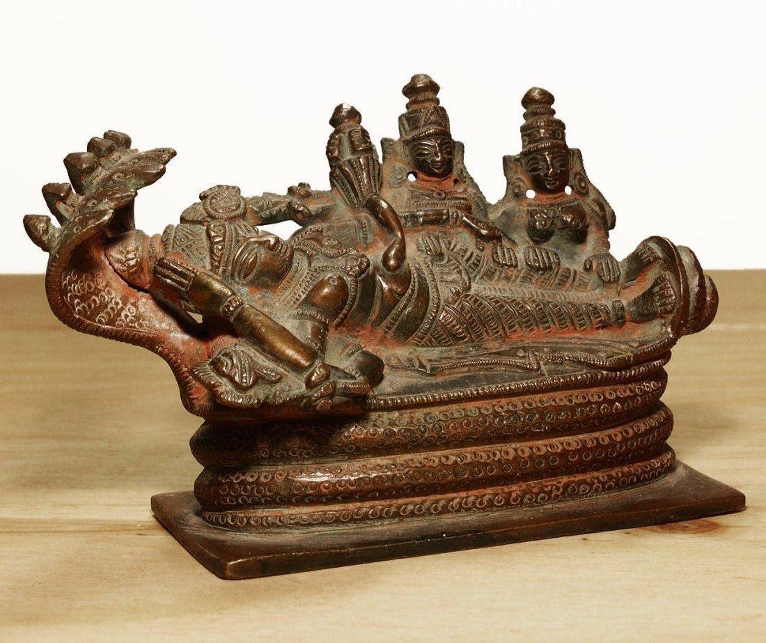 Nepal. Bronze temple statue of sleeping Vishnu. Early - 8