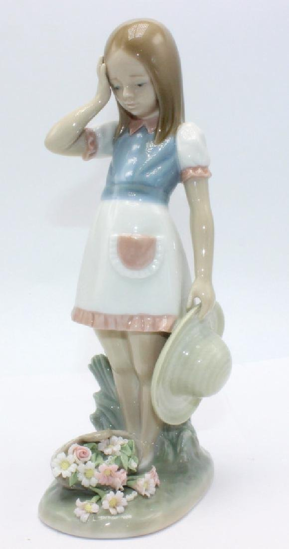 Lladro Girl Holding a Hat with Flower Basket on Ground