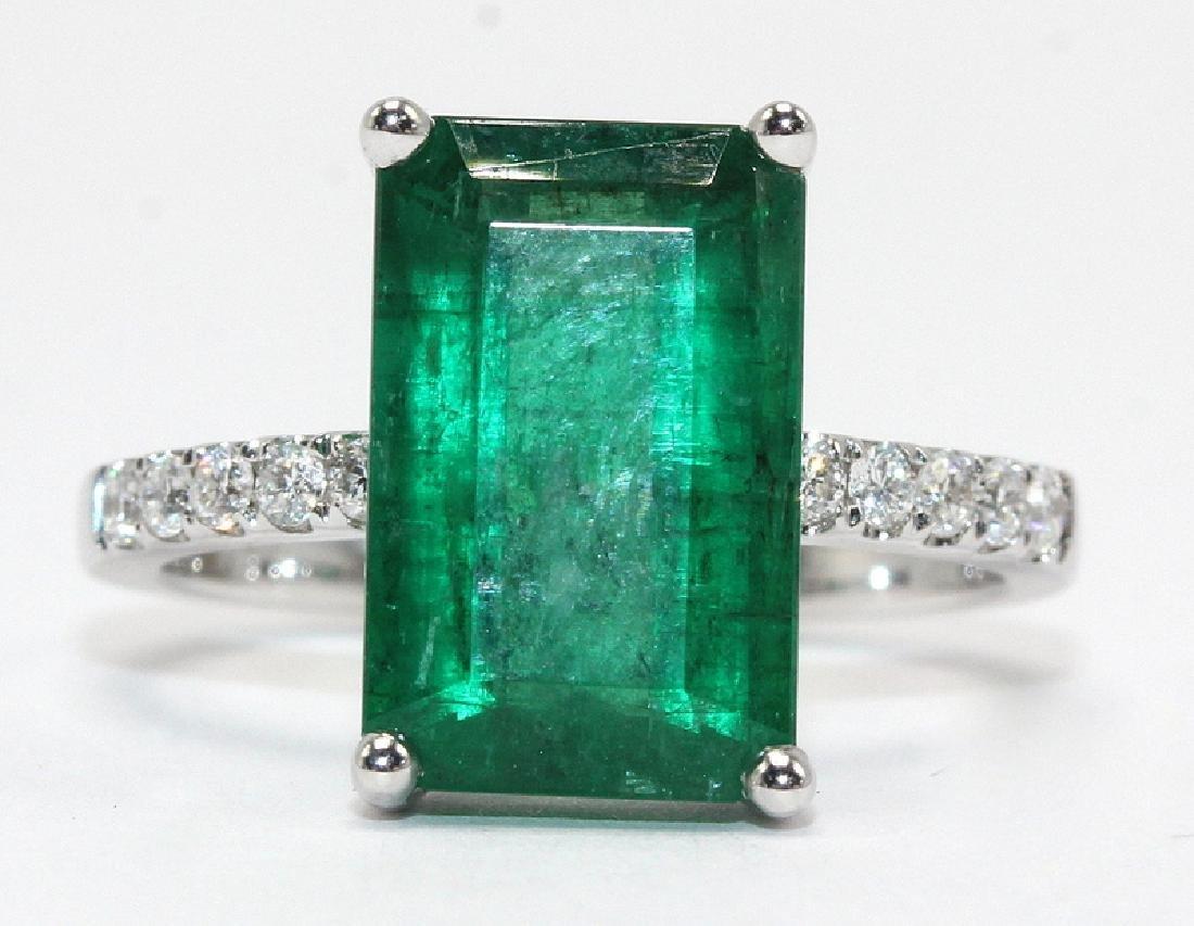 18Kt WG, 0.18ct. Diamond & 4.58ct. Emerald Ring