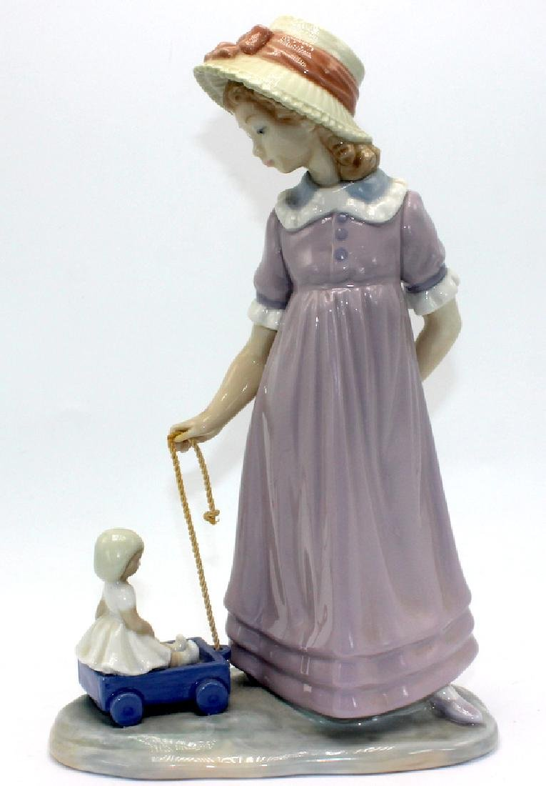 "Lladro Figurine #5044 ""Girl With Toy Wagon"""