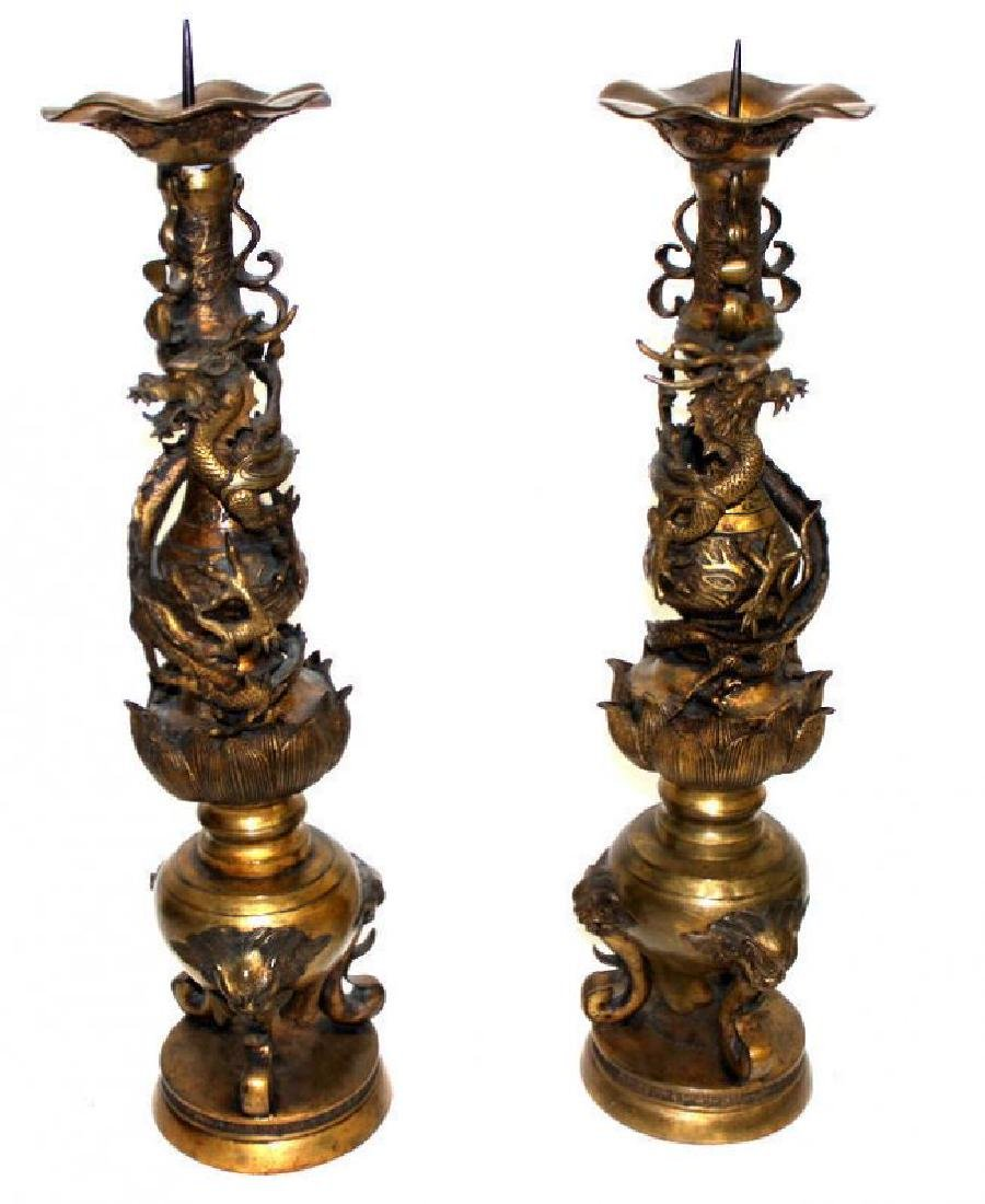 Pair of Antique Chinese Bronze Dragon Candleholders