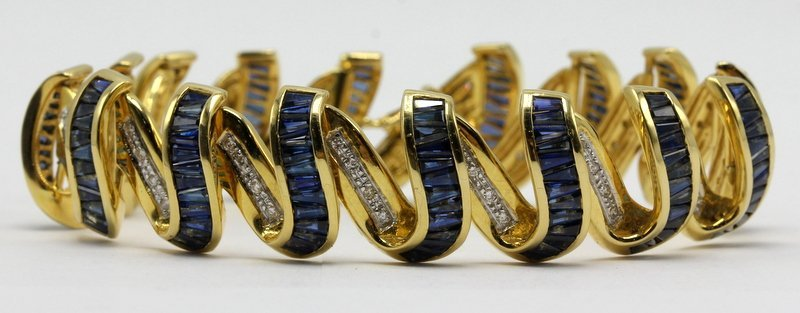 Contemporary Yellow Gold Sapphire and Diamond Ribbon Br