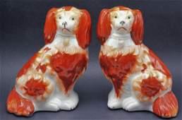 Pair of Stafforshire english porcelain dog figures
