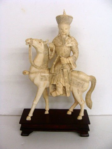 602: ORIENTAL IVORY FIGURE OF WARRIOR ON HORSE
