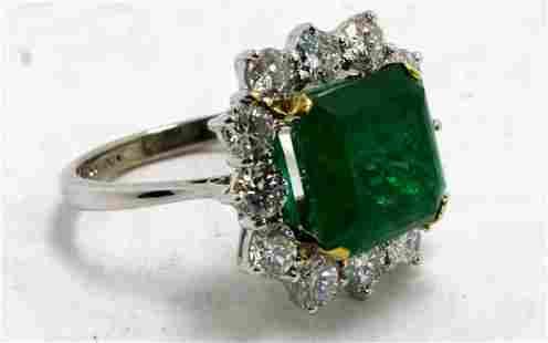 Diamond and 5.72ct Emerald Ring