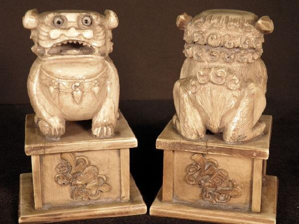 21: Pair Of Carved  Ivory  Figural Temple Dogs on Bases