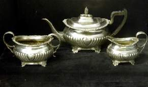 157 English Victorian three piece sterling silver tea