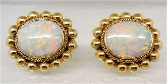 260A Pair of 14K oval Fire Opal cufflinks