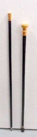 506: Pair of Gold Handled Canes