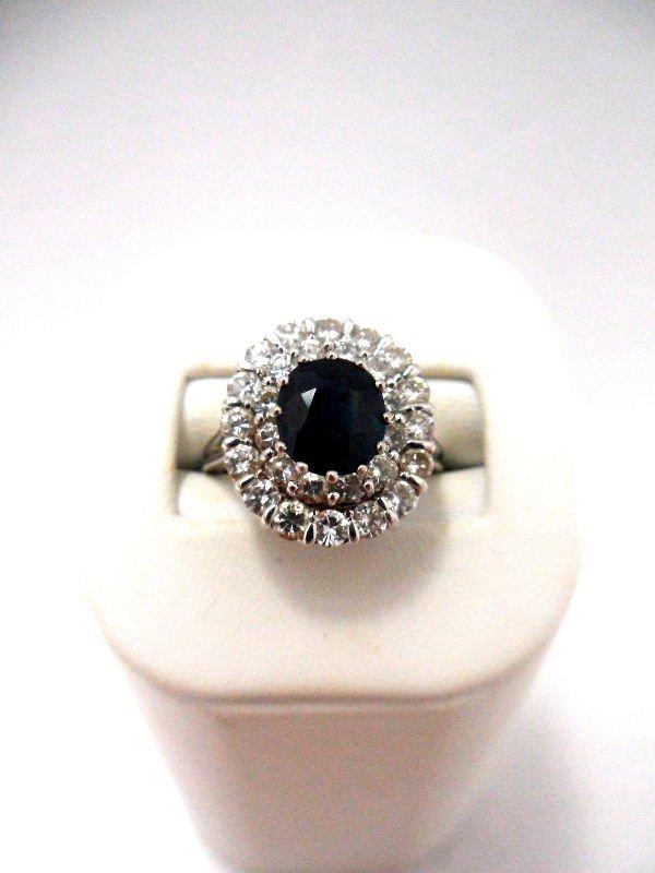 410A: 14K W.G. Diamond & Sapphire Ring