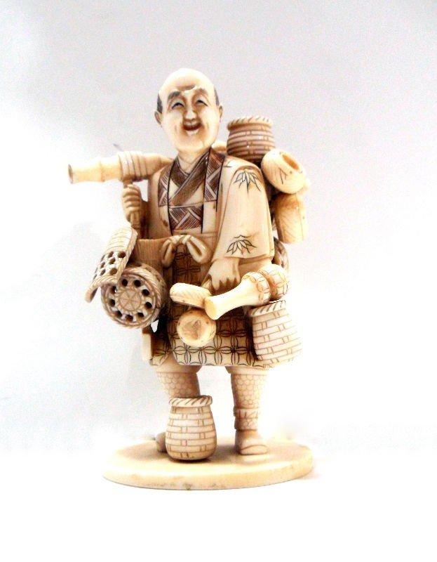 413: Japanese Ivory Figure of a Basket Seller