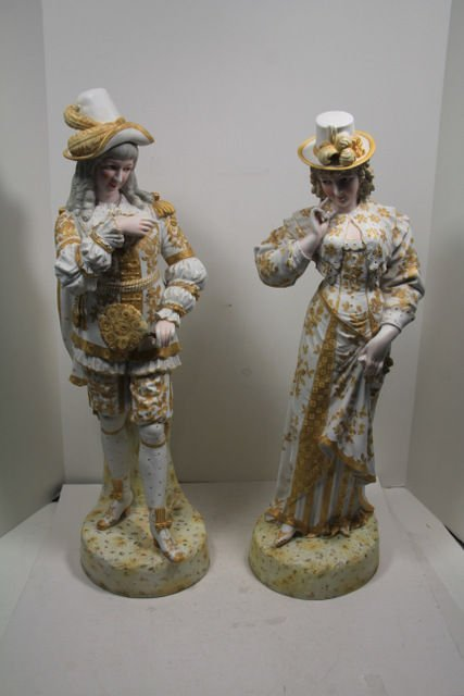17: Striking Pair of Bisque Porcelain Figures