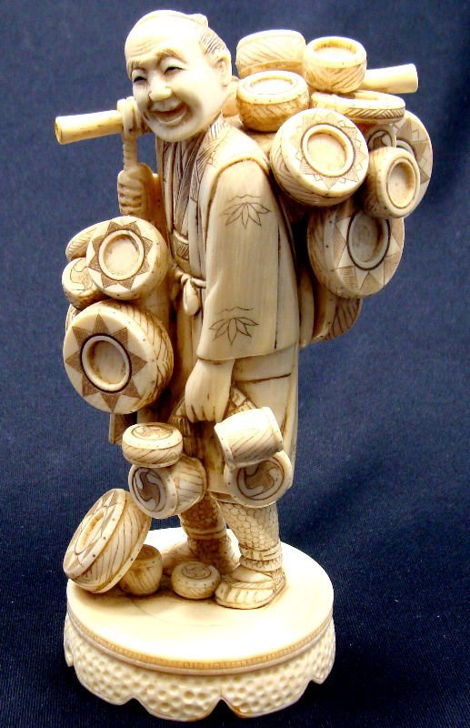 17: Japanese Ivory Carved Figure Basket Seller